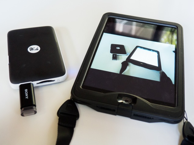 MobileLite with USB drive and SD card (in slot on right side). iPad Minii shows a large preview image from SD card.