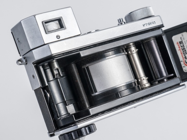 Horizont with back open. Film is exposed by a slit in the silver drum (centre) as it rotates from left to right.