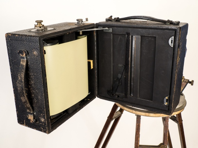 The Cirkut Attachment shown open, with the film loaded. This shows the actual film which, of course, would be light-fogged if the back was open. Ordinarily, the spool of film has a long, light-proof leader that allows the spool to be loaded in daylight without exposing the film.
